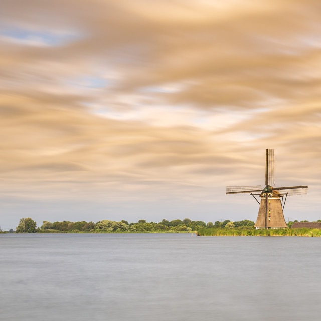 """Old Dutch traditional windmill located at Rottemeren during sunset"" stock image"