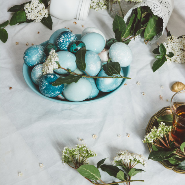 """""""Naturally dyed Easter blue eggs, and tea cup"""" stock image"""