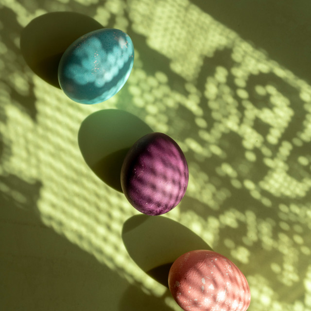 """""""Three Colorful egg easter, painted with natural dyes on green ba"""" stock image"""