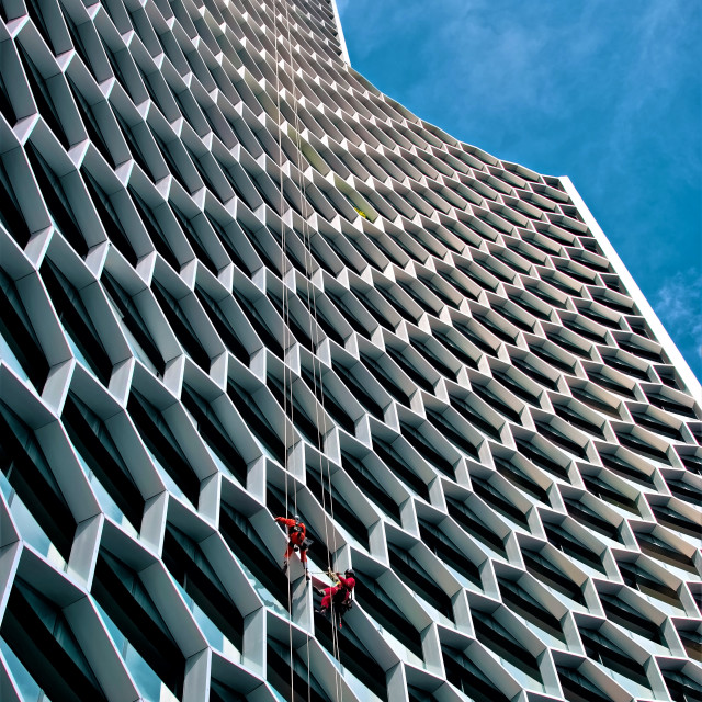 """Cleaning a Skyscraper"" stock image"