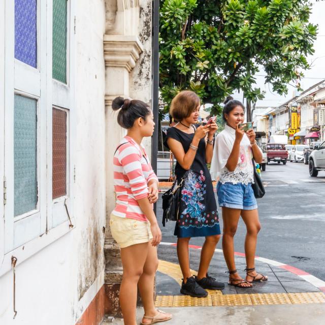 """Asian tourists taking photos"" stock image"