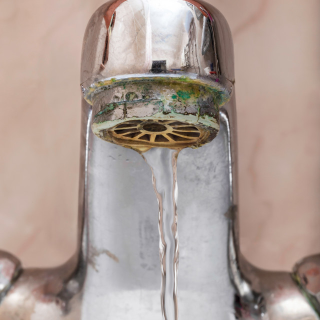 """""""Tap with Water Flowing Slowly"""" stock image"""