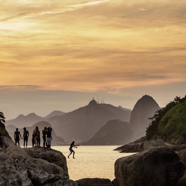 """""""View over rocks of Piratininga towards Rio de Janeiro, sunset, Niteroi, State..."""" stock image"""