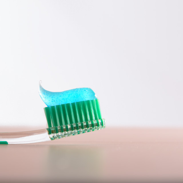 """""""Background with toothbrush with toothpaste on wooden table front"""" stock image"""