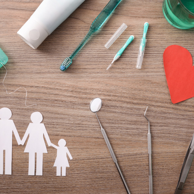 """""""Concept of family dental insurance on table with representative elements"""" stock image"""
