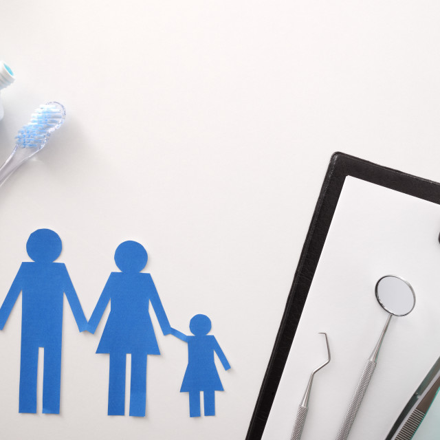 """""""Concept of family dental insurance on white table top"""" stock image"""