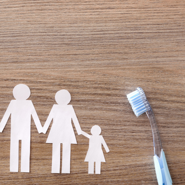 """""""Concept of family dental insurance on wood table"""" stock image"""