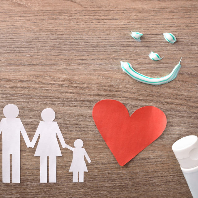 """""""Concept of family dental insurance with representative elements on table"""" stock image"""