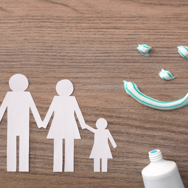 """""""Concept of family dental insurance with representative elements on wood"""" stock image"""