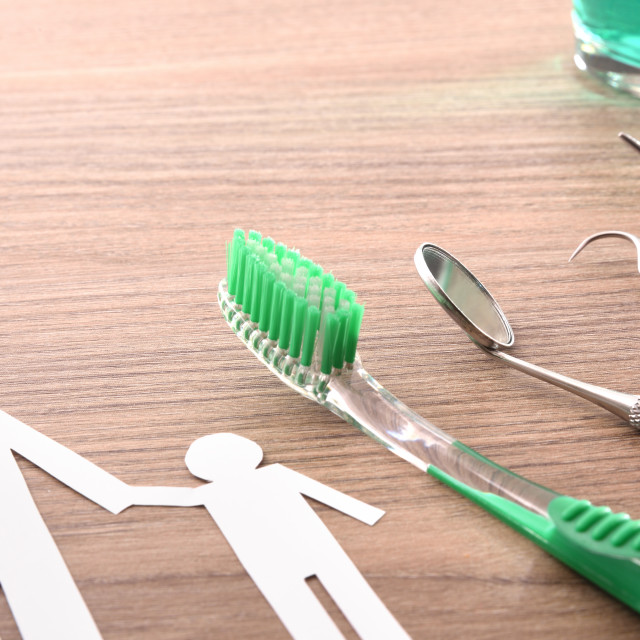 """""""Concept of family dentist with tools on wooden table elevated"""" stock image"""