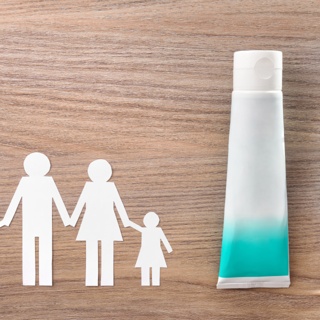 """""""Family concept of dental hygiene tools on wood table top"""" stock image"""