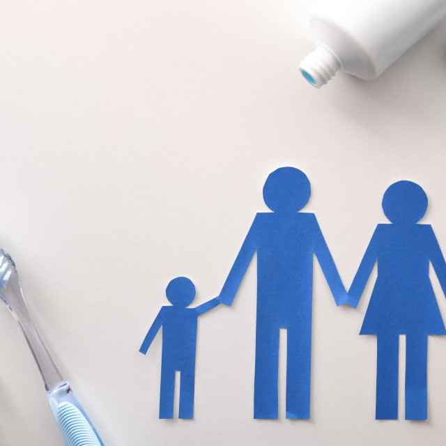 """""""Family dental hygiene with tools on white table top"""" stock image"""