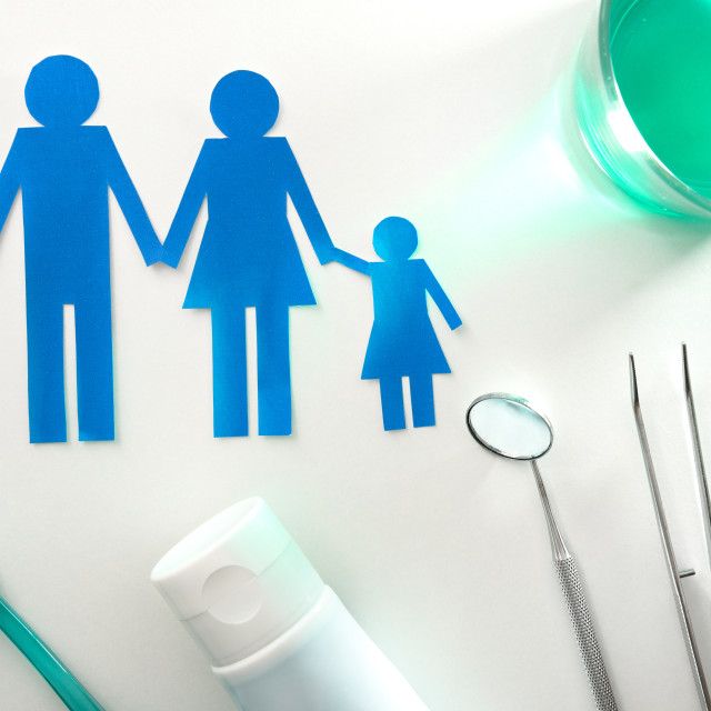 """""""Professional family concept dentist with tools on white table top"""" stock image"""