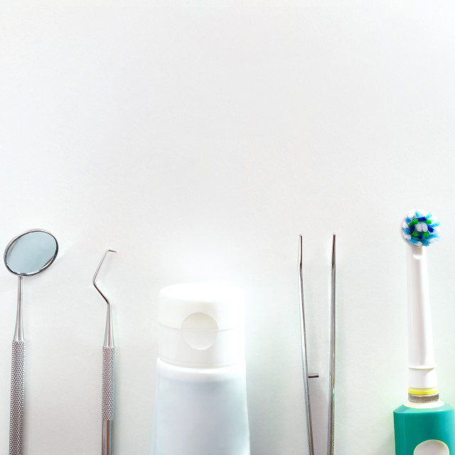 """""""Tools for oral hygiene on white table top"""" stock image"""