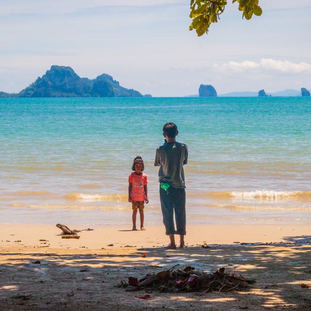 """Kids taking photos on the beach"" stock image"