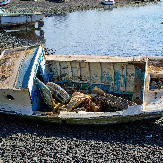 """Abandoned boat, Arrecife harbour"" stock image"