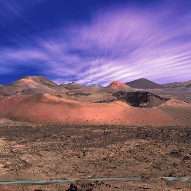 """""""Lanzarote volcanos and moving clouds"""" stock image"""