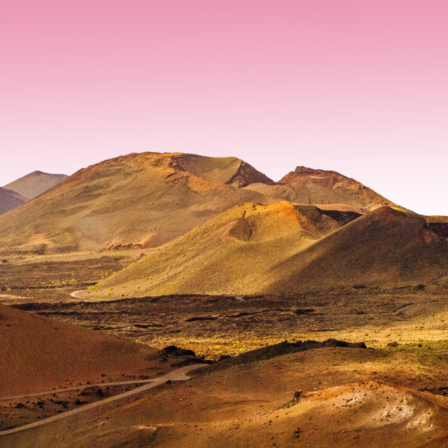 """""""Volcanic landscape with pink sky and high definition foreground, Lanzarote"""" stock image"""
