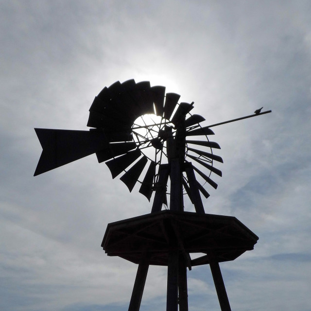 """""""Windmill against the Sun"""" stock image"""