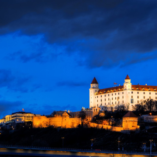 """night view of Bratislava castle from river surface with dramtic"" stock image"