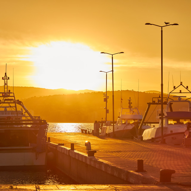 """Sunset light in a harbor the Spanish town Palamos in Costa Brava"" stock image"