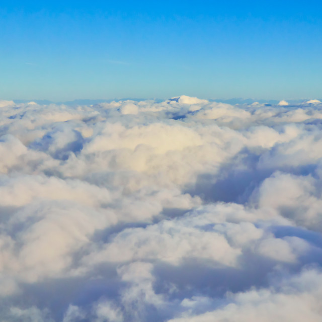 """White clouds from airplane at the morning"" stock image"
