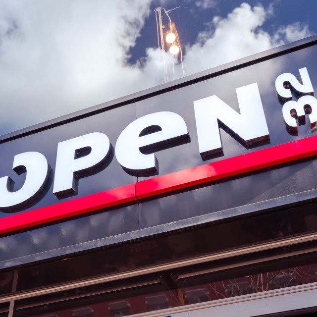 """""""OPEN32 logo on a storefront."""" stock image"""