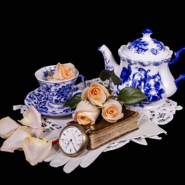 """""""Blue and White Tea set with Peach Roses, Bible and Antique Pocke"""" stock image"""