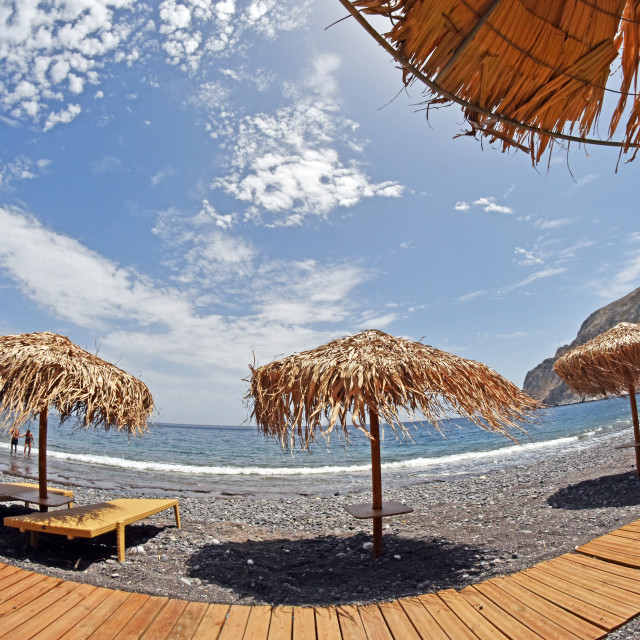 """Parsols and sunbeds on Santorini, Greece beach"" stock image"