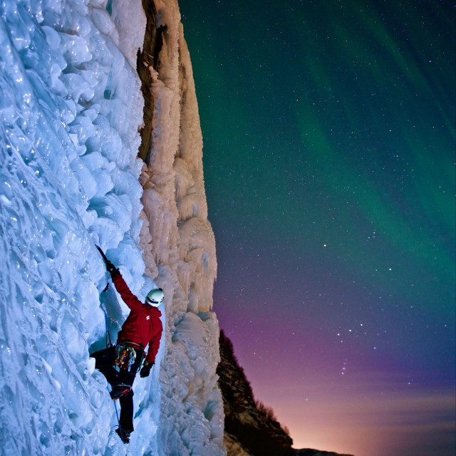 """Ice-climbing under aurora Borealis"" stock image"