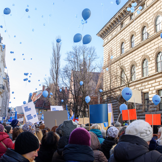 """""""Teachers decides for strange idea- release balloons in the air, during picket, protest for pay rise organised by Latvian Trade Union of Education and Science Employees (LIZDA) near Parliament of Latvia (Saeima)."""" stock image"""