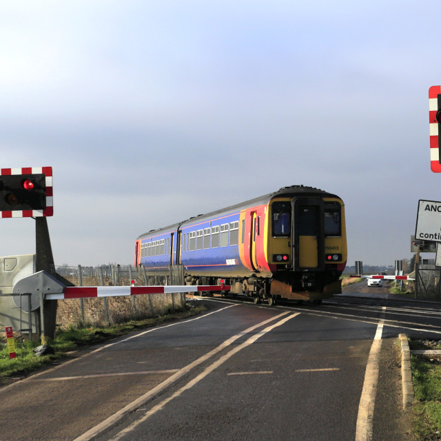 """""""East Midlands trains 156413, Unmanned Level Crossing, March town, Fenland,..."""" stock image"""