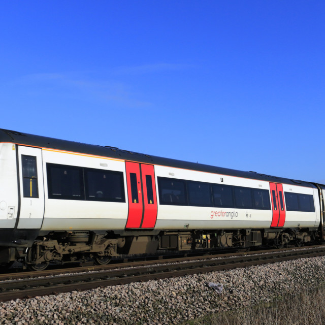 """""""Abellio Greater Anglia, Turbostar 170273 passing an unmanned level crossing,..."""" stock image"""