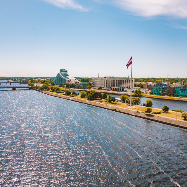 """Latvian flag by the Daugava river"" stock image"