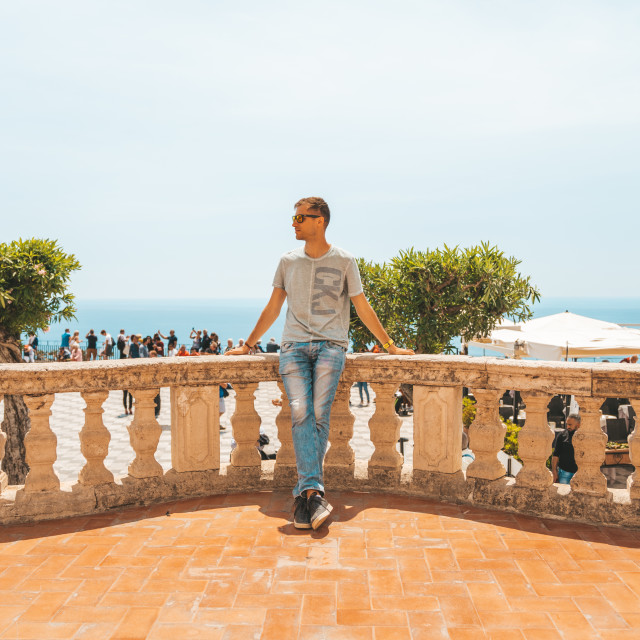 """""""man standing on the balcony by the ocean"""" stock image"""