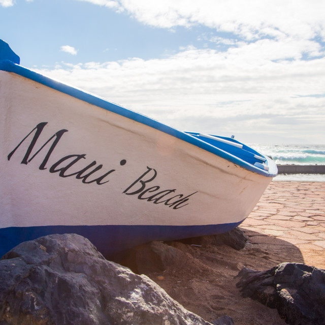 """""""Lonely boat on the shore of the ocean"""" stock image"""