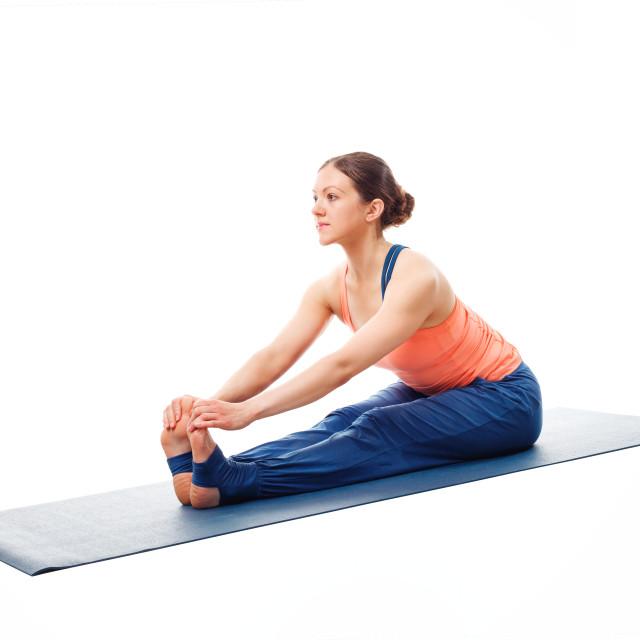 """Woman doing Ashtanga Vinyasa Yoga asana Paschimottanasana"" stock image"