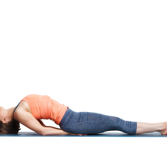 """Beautiful sporty fit yogi girl practices yoga asana Matsyasana"" stock image"