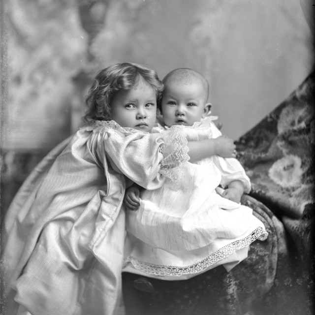 """""""VINTAGE PHOTO OF CHILD HUGGING A BABY"""" stock image"""