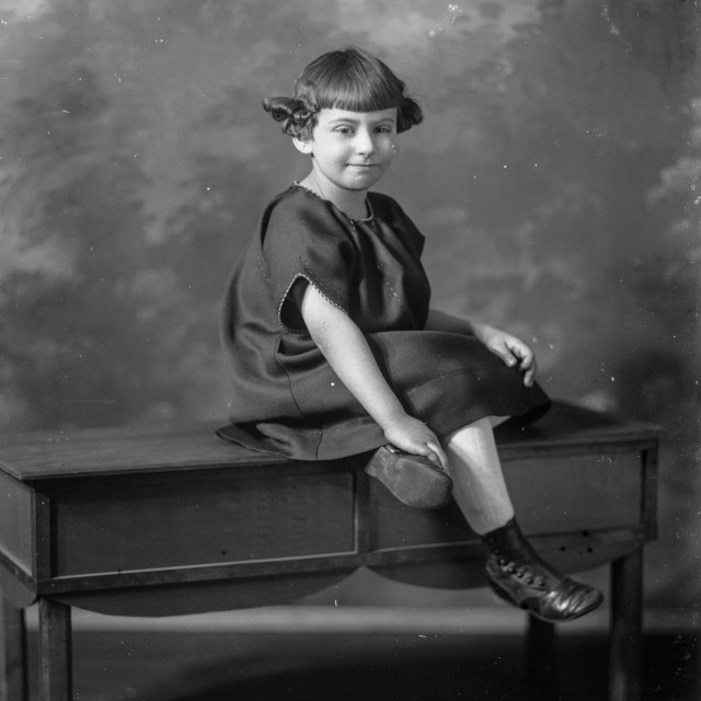 """""""VINTAGE PORTRAIT OF CHILD WITH UNUSUAL HAIRSTYLE"""" stock image"""