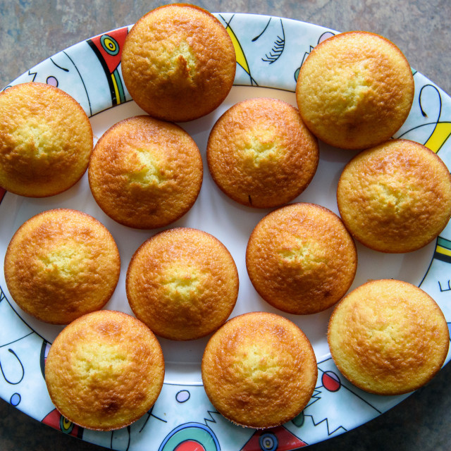 """""""Homemade muffins on colorful plate."""" stock image"""