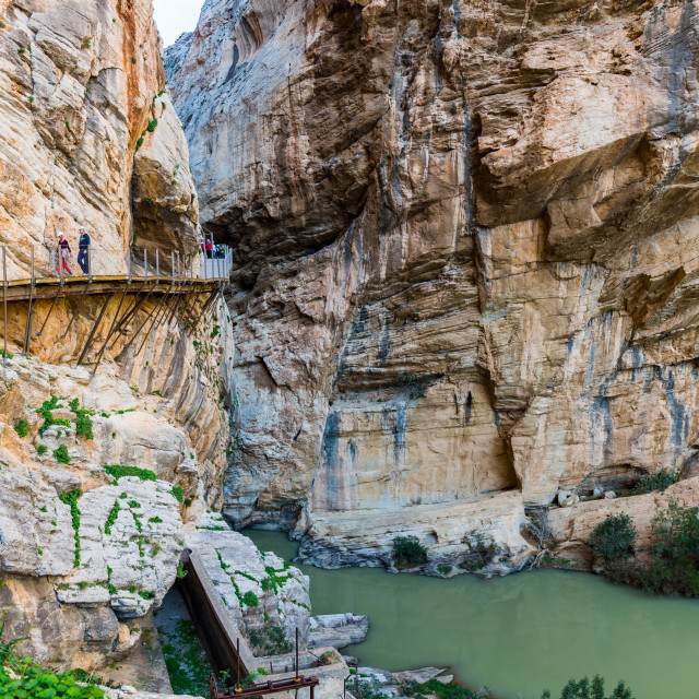 """Wooden path encrusted in yellow cliff going through river canyon in Spain"" stock image"