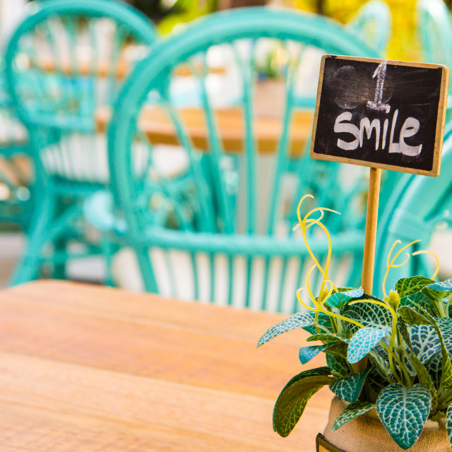 """Small smile sign on a little board. Stay positive and smile."" stock image"