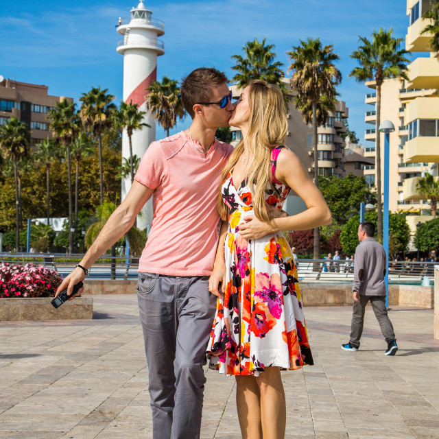 """Young romantic couple boy and girl kissing on the street in Marbella"" stock image"