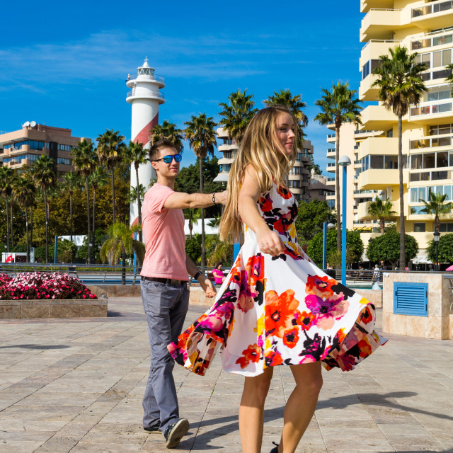 """Young romantic couple boy and girl dancing on the street in Spain"" stock image"