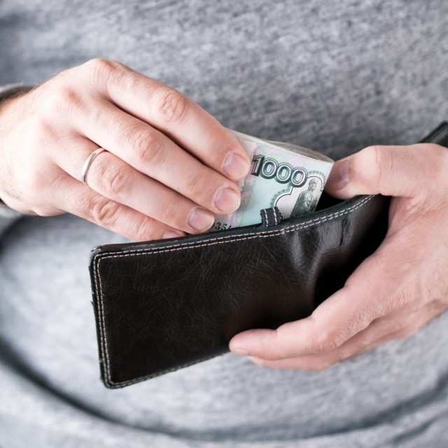 """""""Hands take out russian rubles from wallet"""" stock image"""