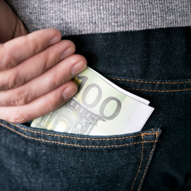 """""""hand put Euro in jeans pocket"""" stock image"""
