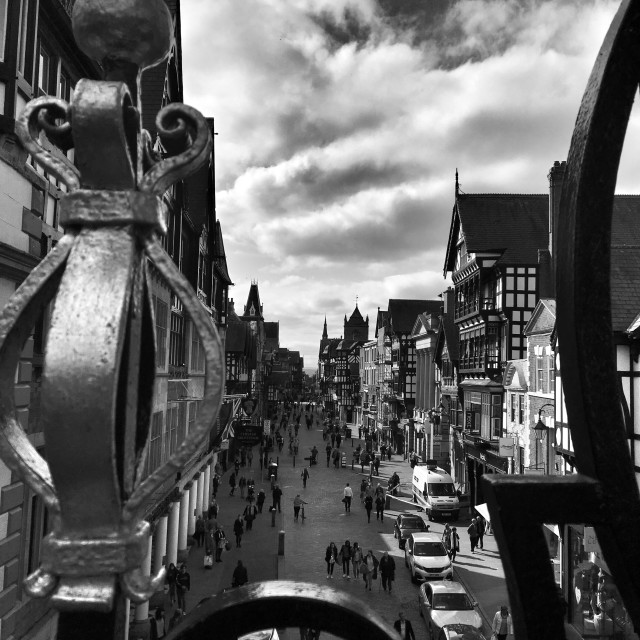 """""""Eastgate Street, Chester. through the railings."""" stock image"""