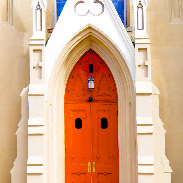 """""""RED CHURCH DOOR WITH BLUE GLASS WINDOWS"""" stock image"""