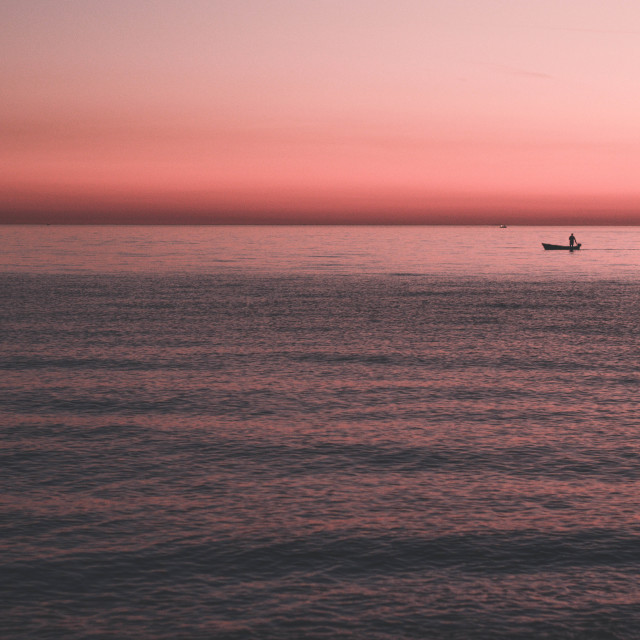 """Fisherman on sunset"" stock image"